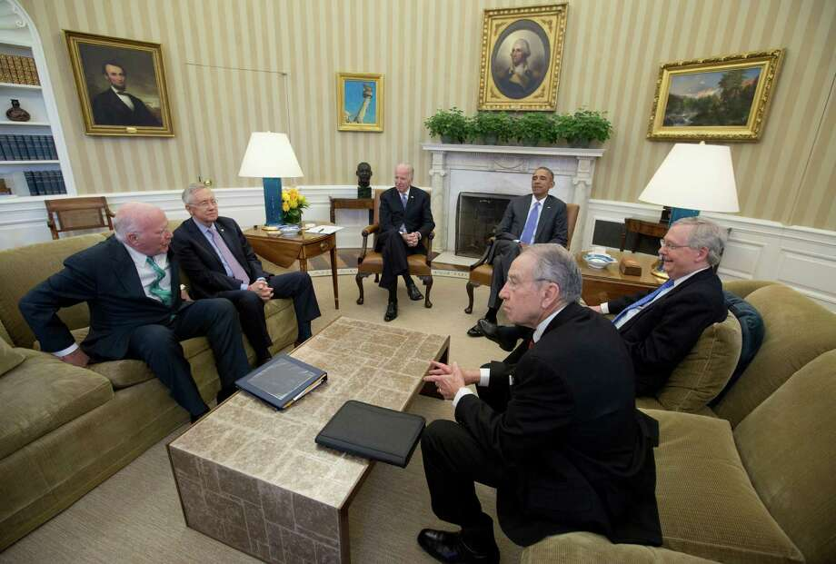 President Barack Obama meets with, from left, the Senate Judiciary Committee's ranking member Sen. Patrick Leahy, D-Vt., Senate Minority Leader Sen. Harry Reid of Nev., Vice President Joe Biden, the president, Senate Majority Leader Mitch McConnell of Ky., and Senate Judiciary Committee Chairman Sen. Chuck Grassley, R-Iowa, in the Oval Office of the White House in Washington, Tuesday, March 1, 2016, to discuss the vacancy in the Supreme Court. Senate Republican leaders are vowing to block the president's Supreme Court nominee, no matter who it is, with the hope of keeping the seat open for a Republican president to fill next year. (AP Photo/Carolyn Kaster) ORG XMIT: DCCK102 Photo: Carolyn Kaster / AP