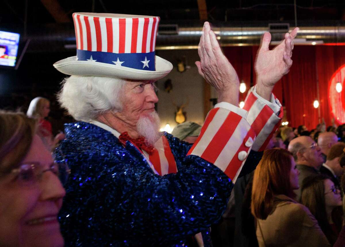 Sen. Ted Cruz supporter John Evans, of Kingwood, applauds as results are announced during a Super Tuesday election watch party on Tuesday, March 1, 2016, in Stafford, Texas, outside Houston.