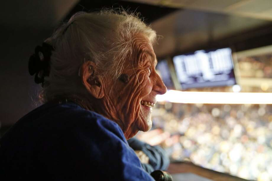 94-year-old Golden State Warriors' fan Lois Stewart enjoys her first Warriors' game as the team plays the Atlanta Hawks during NBA game at Oracle Arena in Oakland, Calif., on Tuesday, March 1, 2016. Photo: Scott Strazzante, The Chronicle