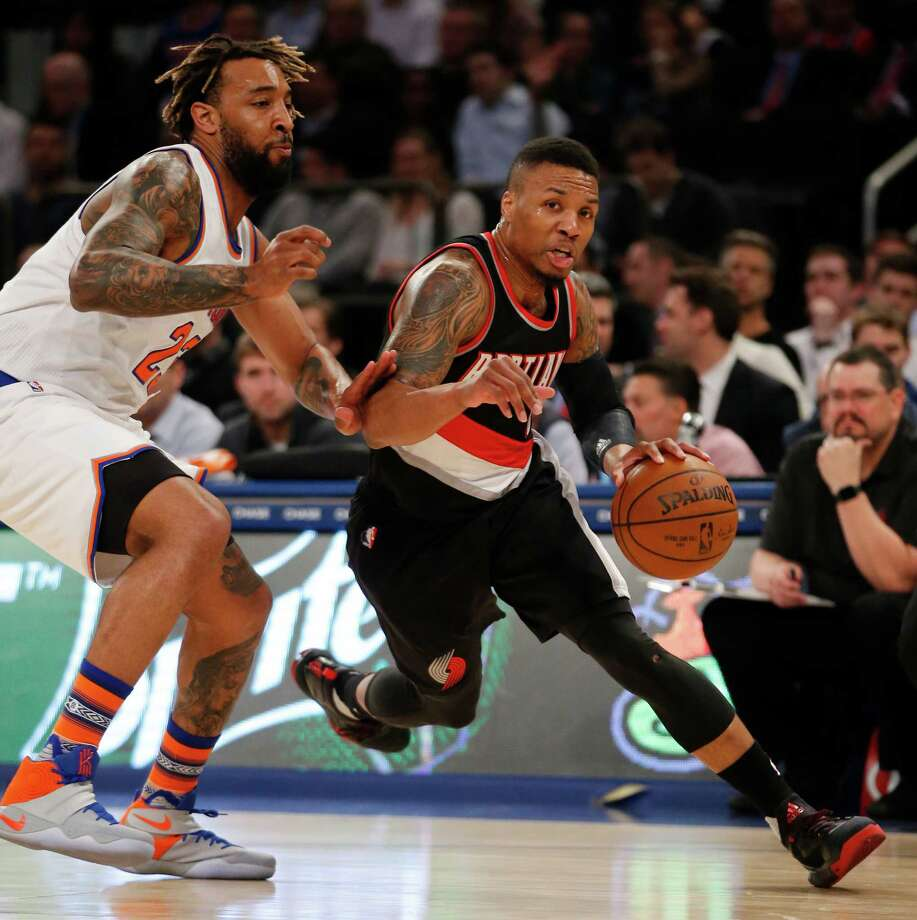 Portland Trail Blazers guard Damian Lillard drives toward the basket as New York Knicks forward Derrick Williams (23) defends during the first half of an NBA basketball game at Madison Square Garden in New York, Tuesday, March 1, 2016. (AP Photo/Kathy Willens) ORG XMIT: MSG101 Photo: Kathy Willens / Copyright 2016 The Associated Press. All rights reserved. This m