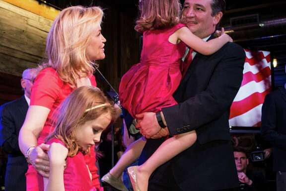 Republican presidential hopeful Sen. Ted Cruz, R-Texas, stands with his family after speaking to his supporters during a Super Tuesday election watch party on Tuesday, March 1, 2016, in Stafford.