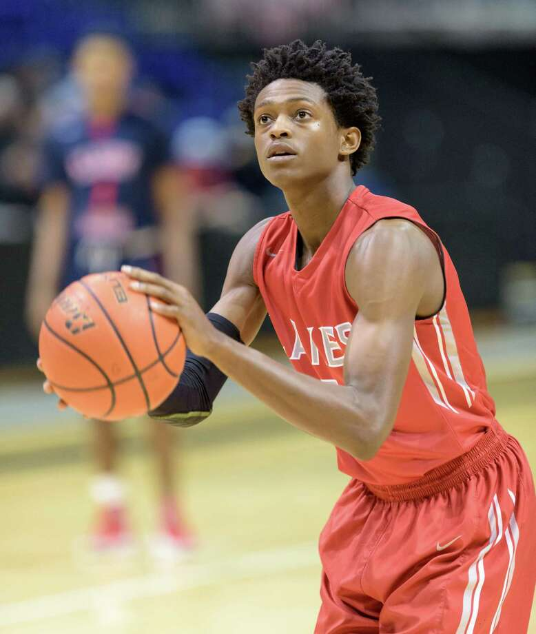 De'Aaron Fox (5) of the Cy Lakes Spartans takes a technical at the start of the game due to the Davis Falcons wearing the wrong uniforms in high school basketball's Class 6A Regional Quarterfinals on Tuesday, March 1, 2016 at the Berry Center. Photo: Wilf Thorne, For The Chronicle / © 2016 Houston Chronicle