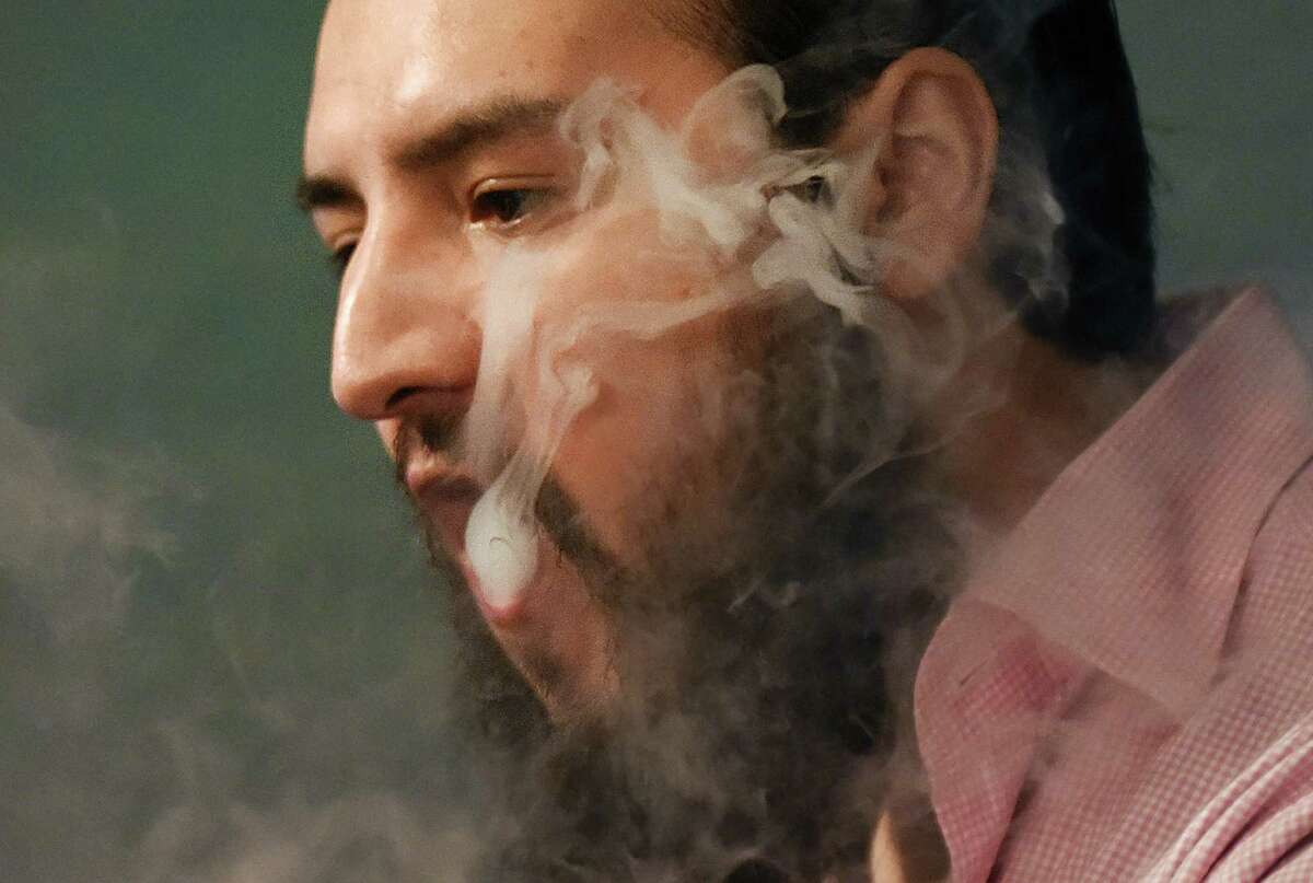 Co-owner Miguel Rivera vapes inside CLOUDS Vapors & Lounge in the Byram section of Greenwich.