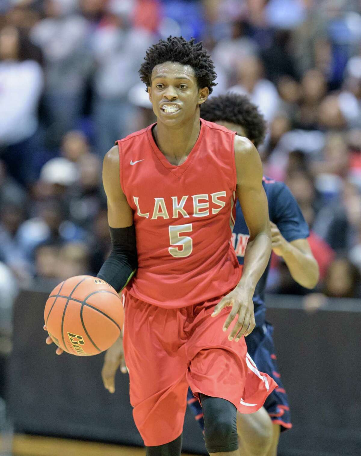 De'Aaron Fox (5) of the Cy Lakes Spartans brings the ball up the court in the second half against the Davis Falcons in high school basketball's Class 6A Regional Quarterfinals on Tuesday, March 1, 2016 at the Berry Center.