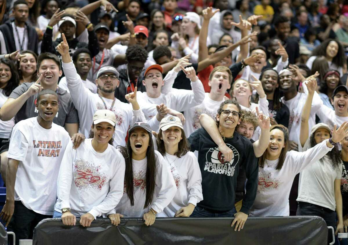 The Cy Lakes Spartan's fans go wild towards the end of the game with their team leading the Davis Falcons in high school basketball's Class 6A Regional Quarterfinals on Tuesday, March 1, 2016 at the Berry Center.