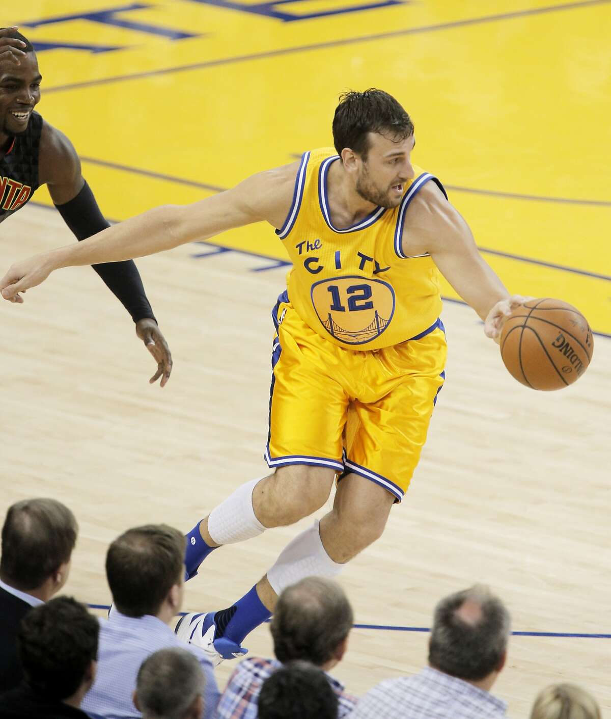Andrew Bogut (12) intercepts a pass in the first half as the Golden State Warriors played the Atlanta Hawks at Oracle Arena in Oakland, Calif., on Tuesday, March 1, 2016.