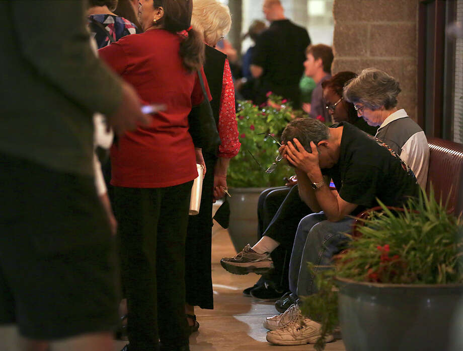 5 San Antonio polls expected to be the busiest on Nov. 81. Huebner Elementary:16311 Huebner Rd.Photo: Saul Carbajal, right, rests his head in his hands as he and some 36 people wait outside Huebner Elementary School to vote at 9:30 PM on Tuesday, March 1, 2016, with another 20 or so inside the school. Photo: Bob Owen, San Antonio Express-News / ©2016 San Antonio Express-News