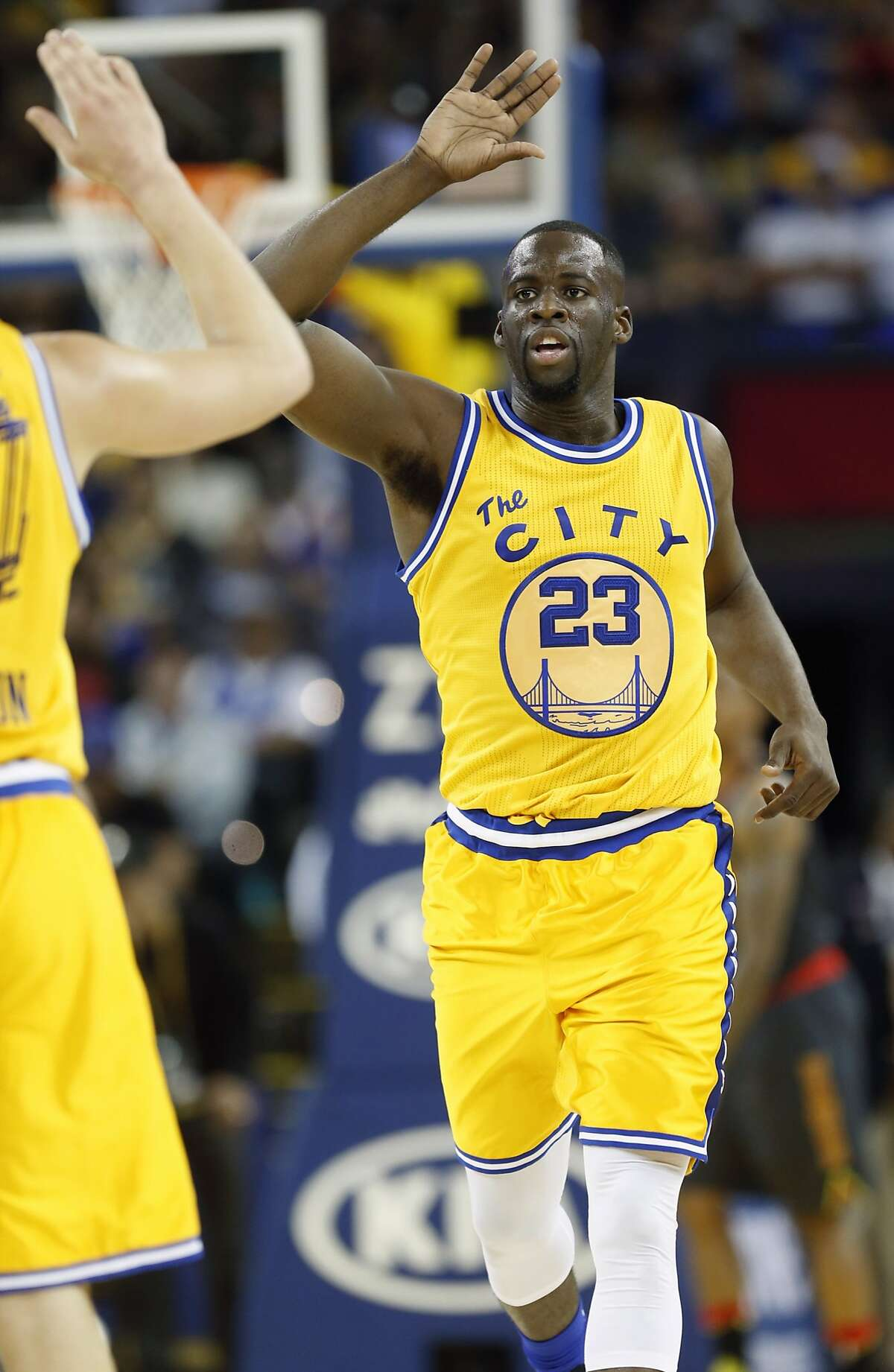 Golden State Warriors' Draymond Green celebrates a basket in 2nd quarter against Atlanta Hawks during NBA game at Oracle Arena in Oakland, Calif., on Tuesday, March 1, 2016.