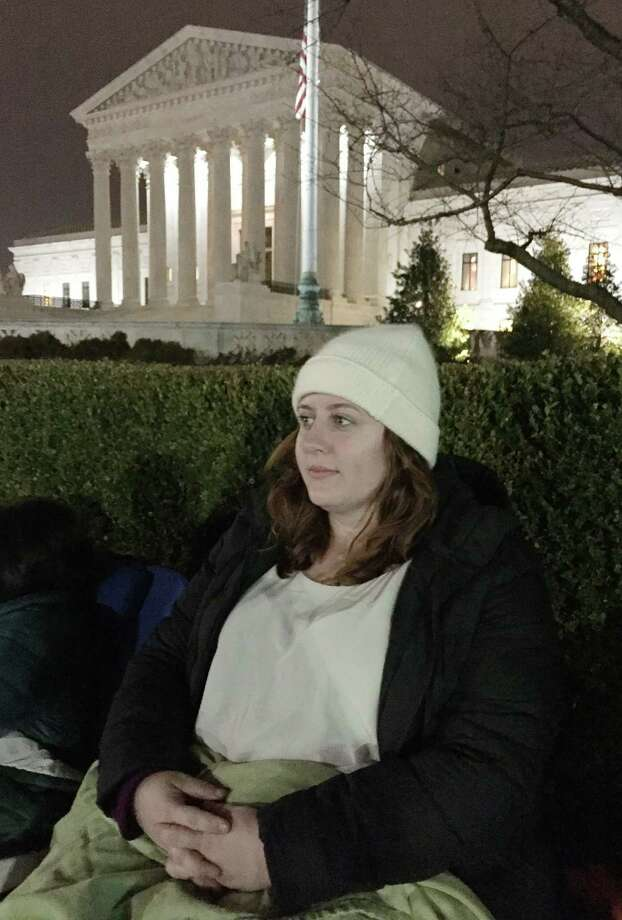 "Anne Swift, 28, a University of Texas at Austin law student, traveled to Washington, D.C., to watch the oral arguments in the landmark abortion case that started in her home town. Among the classes she skipped: ""federal courts."" Photo: Brian M. Rosenthal / Houston Chronicle"