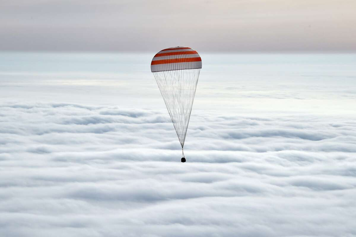 Russias Soyuz TMA-18M space capsule carrying the International Space Station (ISS) crew of US astronaut Scott Kelly and Russian cosmonauts Mikhail Kornienko and Sergei Volkov lands in a remote area outside the town of Dzhezkazgan, Kazakhstan, on March 2, 2016. US astronaut Scott Kelly and Russian cosmonaut Mikhail Kornienko returned to Earth on March 2 after spending almost a year in space in a ground-breaking experiment foreshadowing a potential manned mission to Mars.
