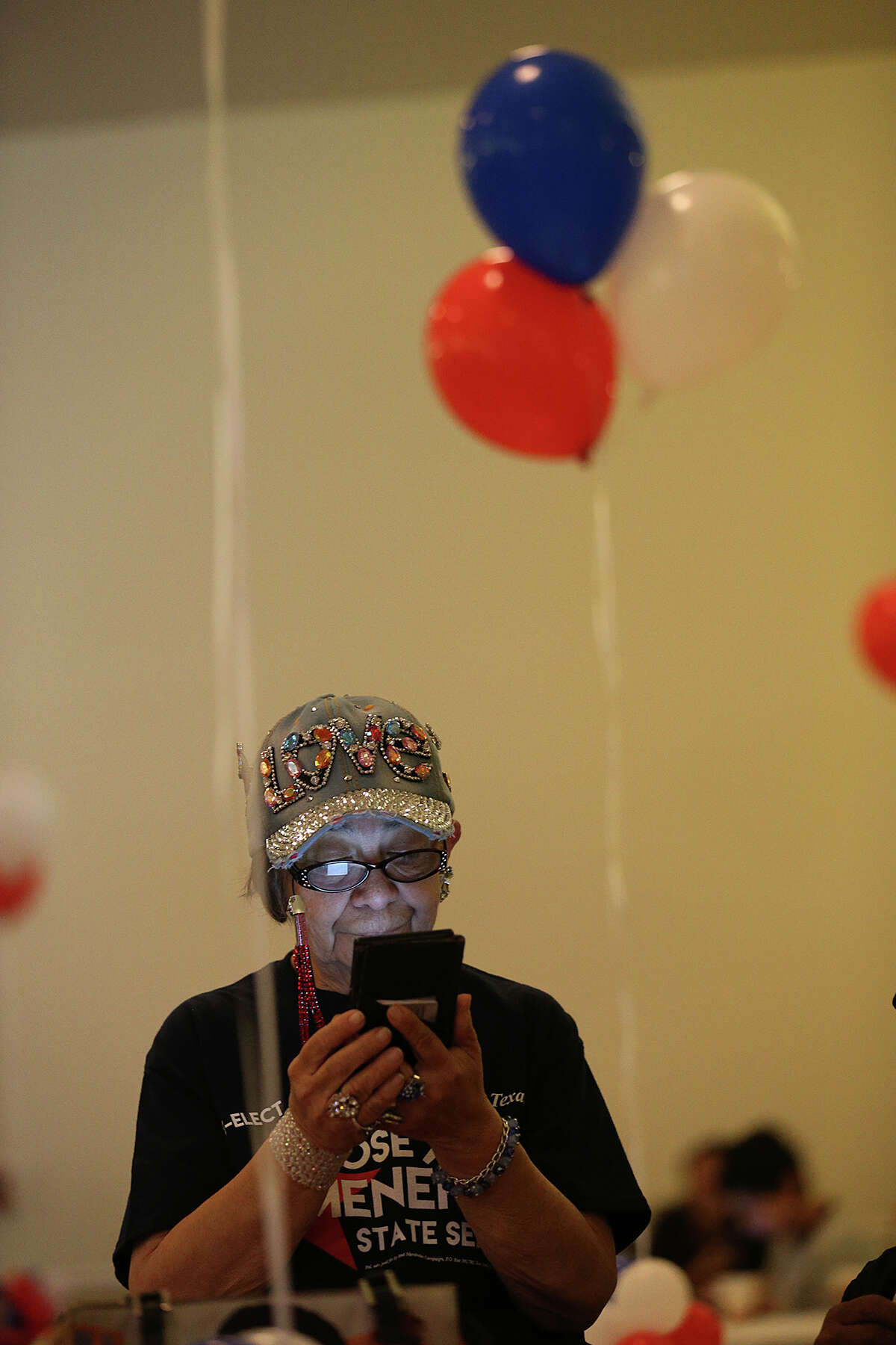 Mary Garcia checks on the results for the race between Texas State Senator Jose Menendez, (D-26) and challenger Trey Martinez-Fischer during a party at the San Antonio Fire Fighters Union Hall, Tuesday, March 1, 2016. Menendez was up with almost 55-percent with Martinez-Fischer at 45-percent in early voting results.