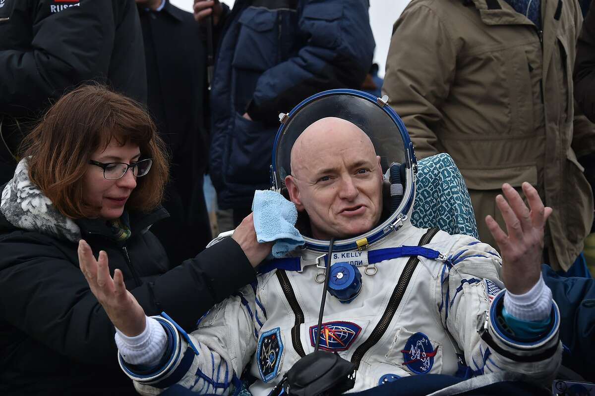 International Space Station (ISS) crew member Scott Kelly of the U.S. reacts after landing near the town of Dzhezkazgan, Kazakhstan, on March 2, 2016. US astronaut Scott Kelly and Russian cosmonaut Mikhail Kornienko returned to Earth on March 2 after spending almost a year in space in a ground-breaking experiment foreshadowing a potential manned mission to Mars.