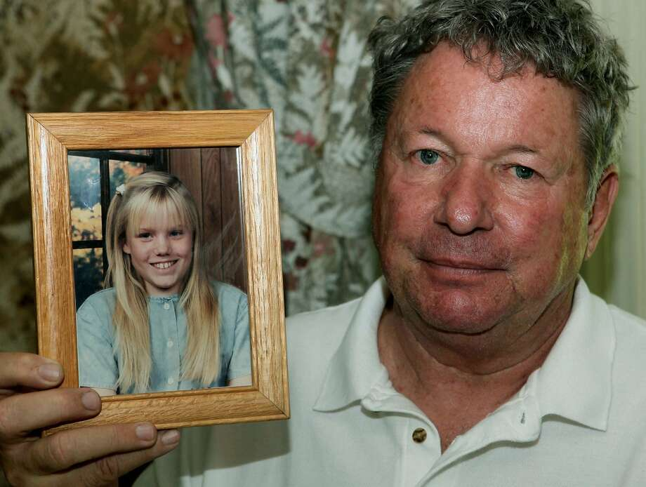 Carl Probyn, 60, stepfather of Jaycee Lee Dugard who went missing in 1991, holds photos of his stepdaughter at his home in Orange, Calif., Thursday, Aug. 27, 2009. (AP Photo/Nick Ut) Photo: Nick Ut, AP