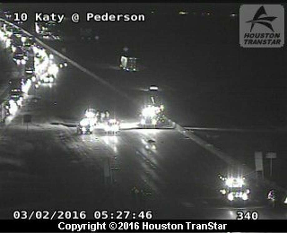 A fatal crash about 5:15 a.m. Wednesday on eastbound  I-10 in Katy forced officials to shut down the freeway. Photo: Houston TranStar