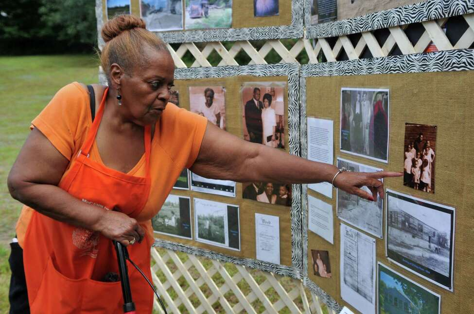 Ann Standfield points at an old photo of herself on Rapp Road on Saturday, Aug 15, 2015, in Albany, N.Y. (Phoebe Sheehan/Special to The Times Union)