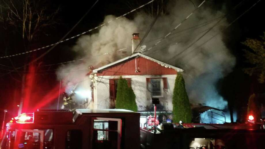 Danbury firefighters battle a blaze at 9 Stevens St. that killed one person and left two others in critical condition early Wednesday. Photo: Contributed / Marta Cruz