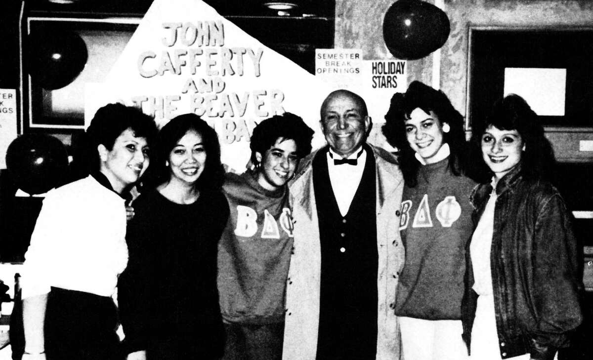 Dean John Croffy with students in 1987.