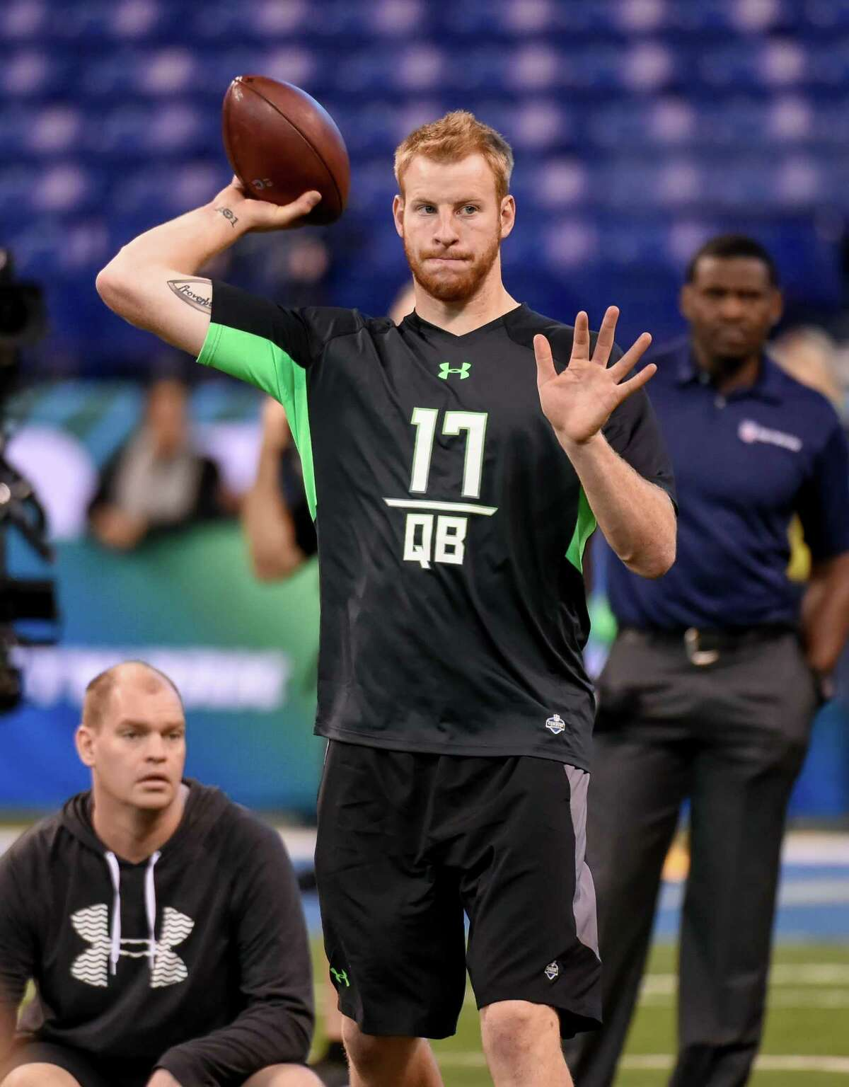 North Dakota State quarterback Carson Wentz runs a drill at the NFL Scouting Combine on Feb. 27, 2016, in Indianapolis.