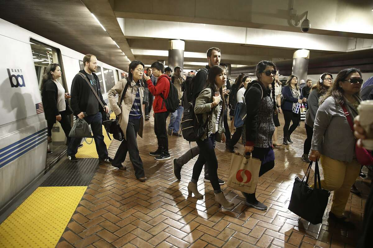 Commuters get off the train at the Montgomery BART station during the morning commute in San Francisco, California, on monday, february 29, 2016. BART will be testing offering incentives for commuters riding outside during the busiest time of the morning.