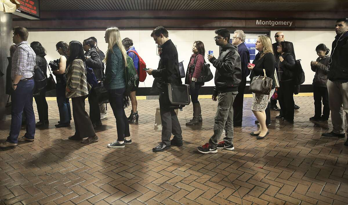 Commuters wait for the escalator at the Montgomery BART station during the morning commute in San Francisco, California, on monday, february 29, 2016. BART will be testing offering incentives for commuters riding outside during the busiest time of the morning.