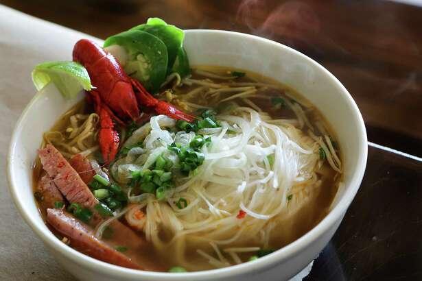 A steaming bowl of Crawfish Pho at LA Crawfish.