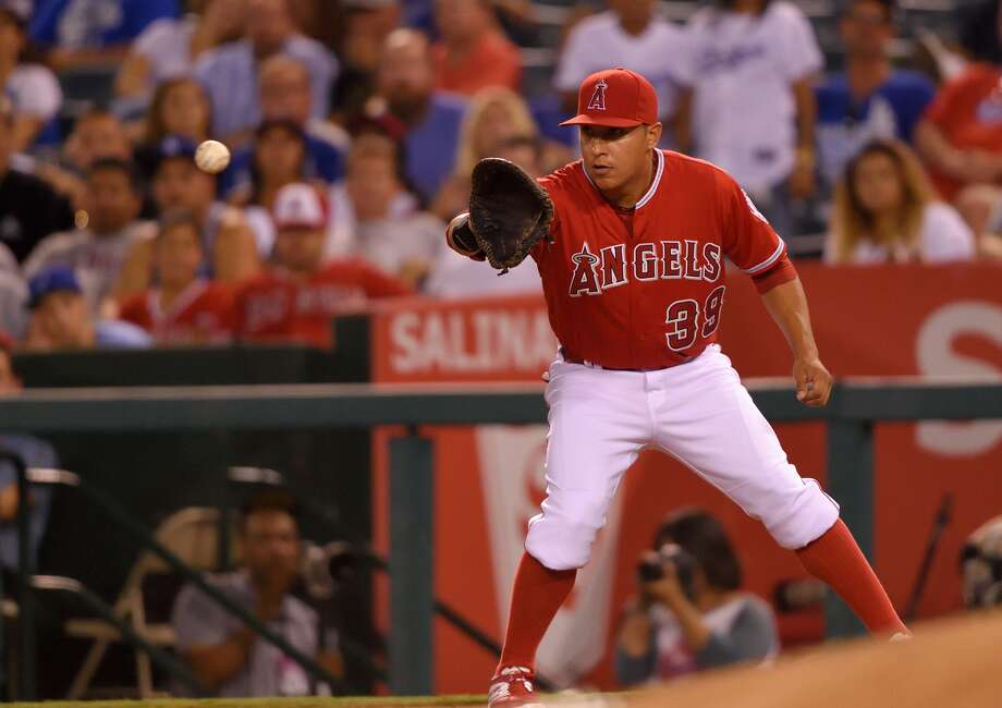 ANAHEIM, CA - Efren Navarro #39 of the Los Angeles Angels of Anaheim catch the game-ending out during the game against the Los Angeles Dodgers at Angel Stadium of Anaheim on September 9, 2015. (Photo by Matt Brown/Angels Baseball LP/Getty Images)