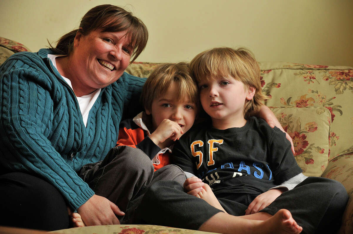 Lindsey Clark and her six-year-old twin boys Jeremy (in stripes) and Miles in their Darien home last year. Jeremy and Miles have Dravet syndrome, a form of childhood epilepsy. A bill Clark supprted last year that would allow parents to give children medical marijuana, has been revived this year.
