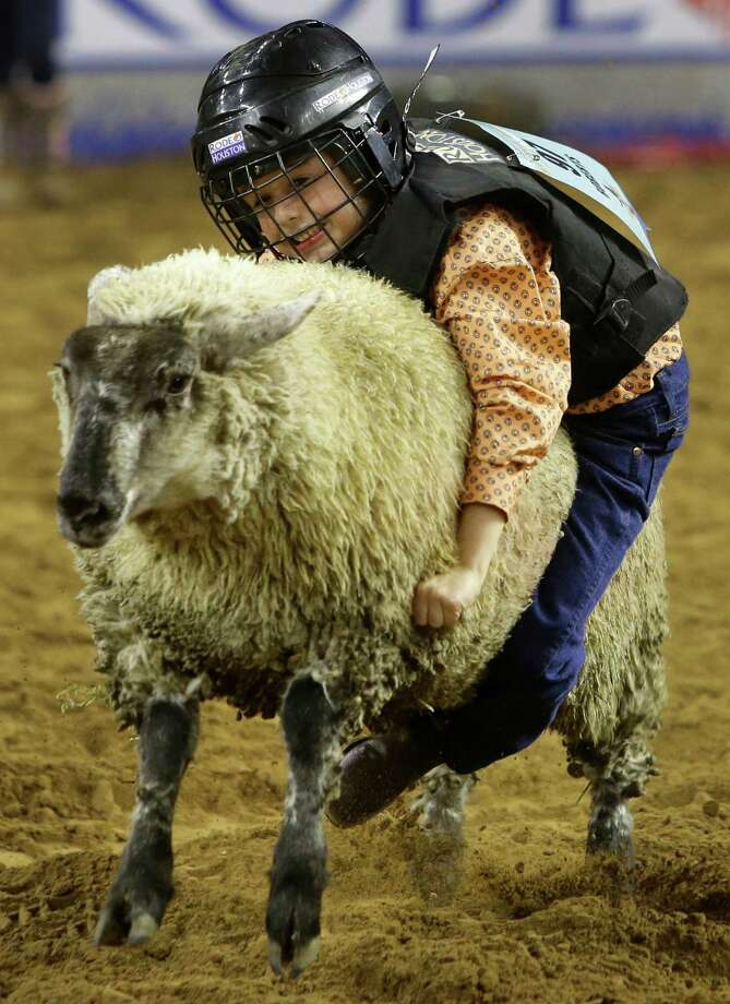 The rain and wind might make RodeoHouston a bit soggy this week but we always have Mutton Bustin' to look forward to.  Photo: Melissa Phillip, Staff / © 2014  Houston Chronicle
