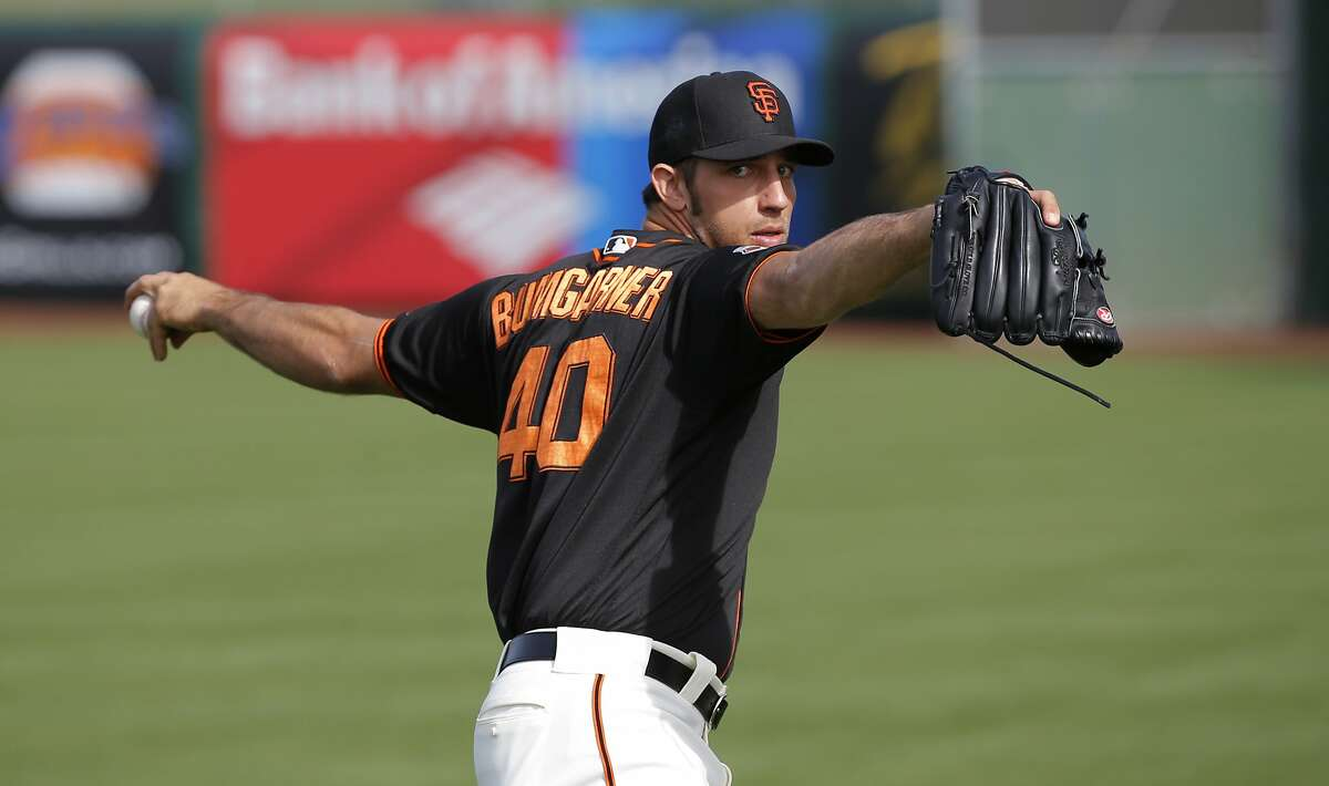 Pitcher Madison Bumgarner, 40 during morning workouts as the San Francisco Giants prepare to play the Los Angeles Angels at Scottsdale Stadium on Wed. March 2, 2016, in Scottsdale, Arizona.
