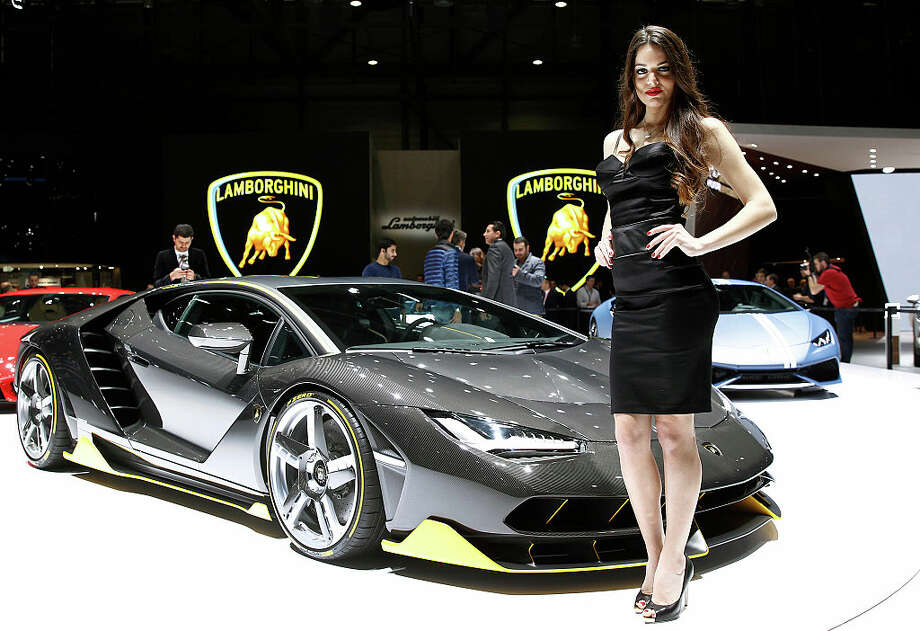 A model poses next to a Lamborghini Centenario model during the first press day of the 86th Geneva International Motor Show on March 1, 2016 in Geneva, Switzerland. The 86th International Motor Show which runs from March 3 to 13, 2016 will present novelties in the car industry. Photo: Chesnot, Getty Images / 2016 Chesnot