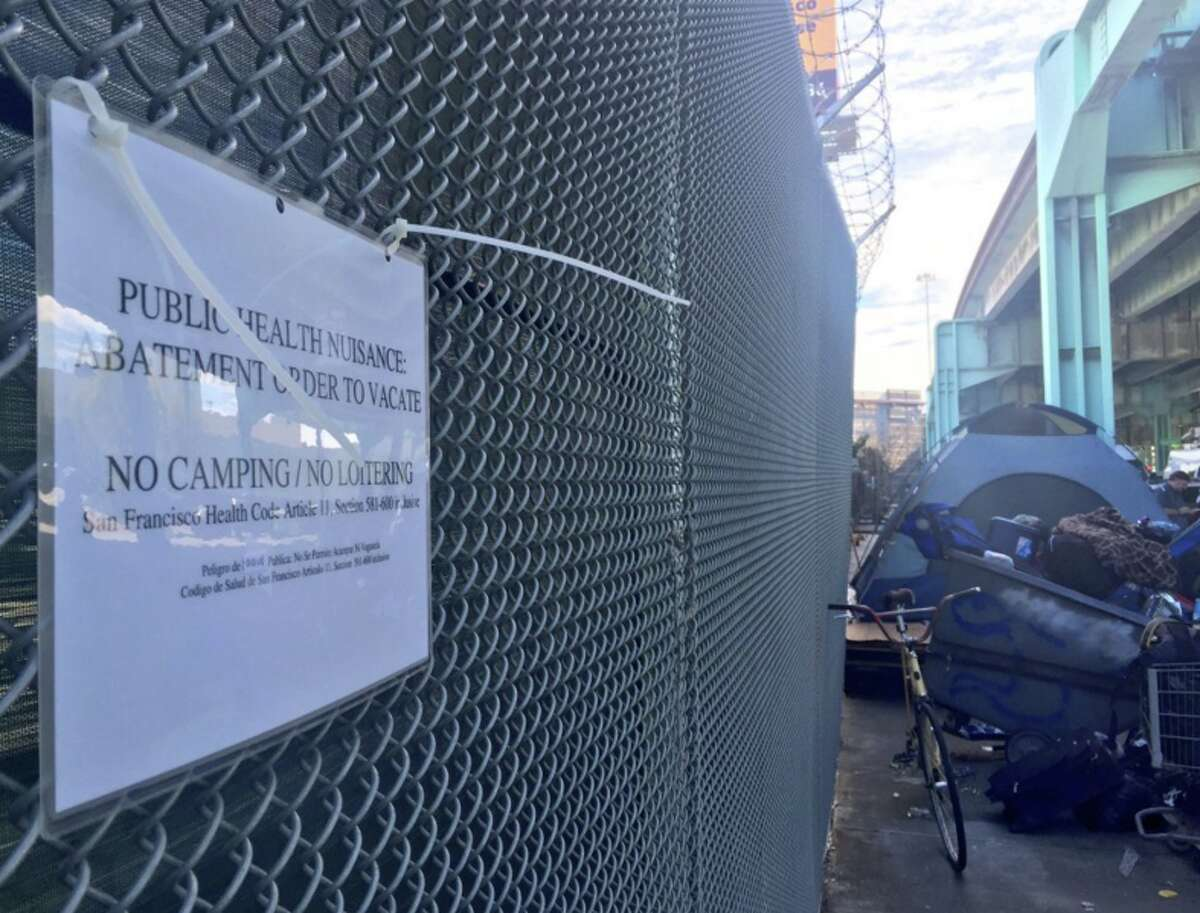 Public nuisance signs went up as the last tent on Division Street was broken down in San Francisco on Tuesday, March 1, 2016.