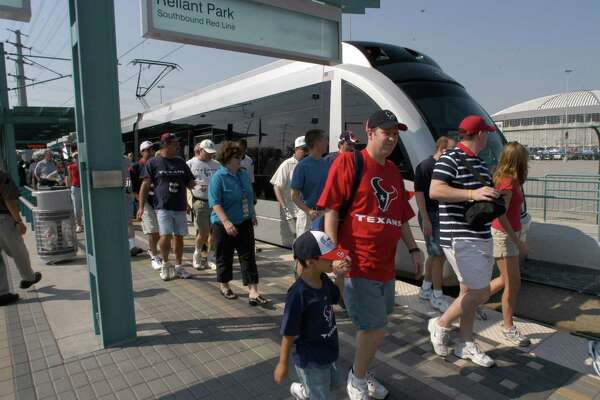 Passagers unload the Metro Rail at the Reliant Station heading for the game.  Features of the Metro Rail line at Reliant Park Station for the first regular season Houston Texans game.  Pix of fans using the rail system to get to the game.   09/12/2004   (E. Joe Deering/Chronicle)     HOUCHRON CAPTION (09/13/2004):  EASY RIDERS:  MetroRail passengers head to Reliant Stadium on Sunday for the Texans-Chargers football game.
