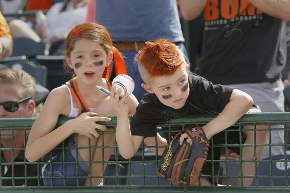 Looking for an autograpah Sydney Forester, 9 and her brother Logan, 5 of Clovis, Ca. as the San Francisco Giants get ready to play agianst the Los Angeles Angels at Scottsdale Stadium on Wed. March 2,  2016, in Scottsdale, Arizona.