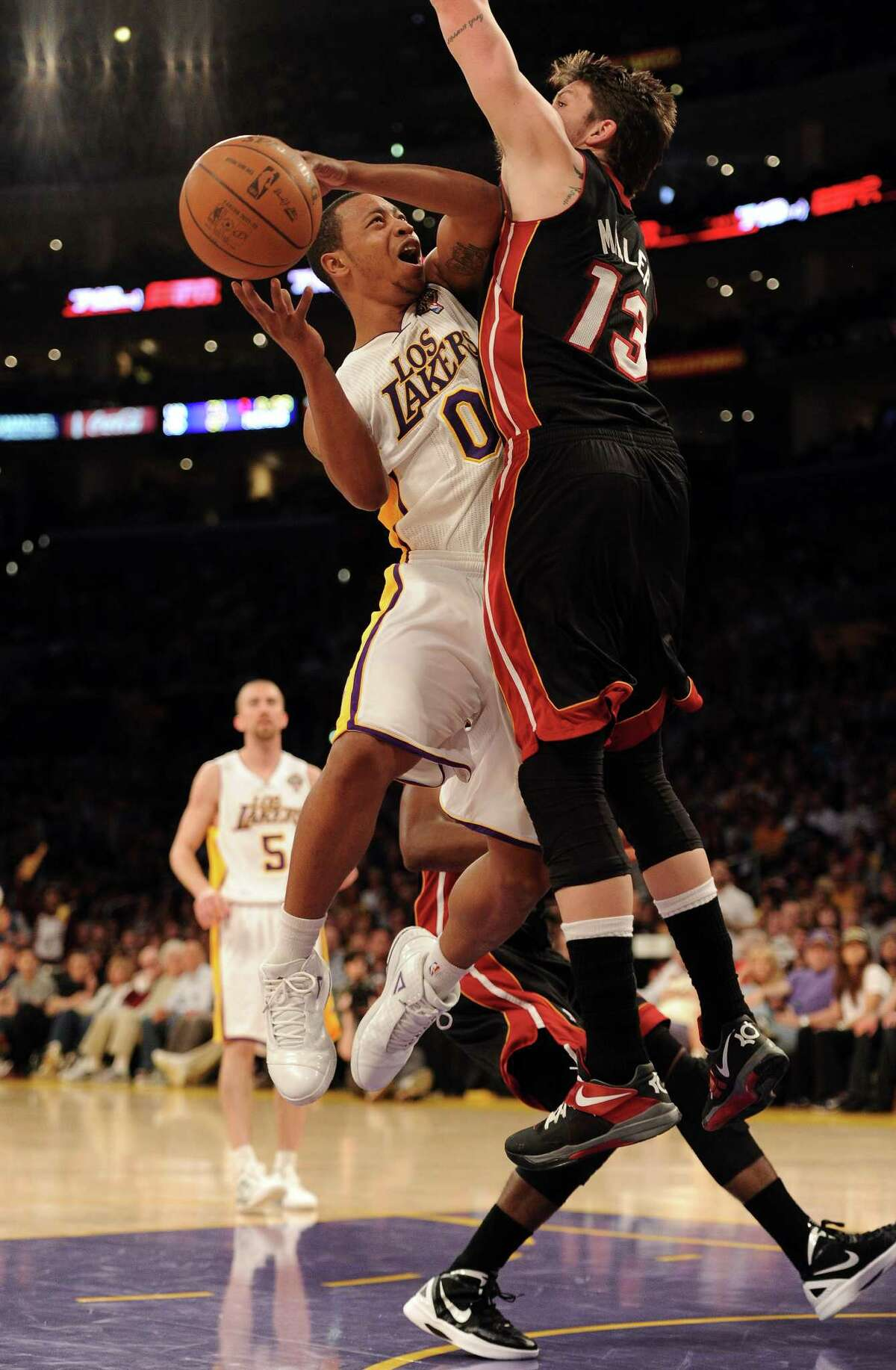 LOS ANGELES, CA - MARCH 04: Andrew Goudelock #0 of the Los Angeles Lakers has his shot blocked by Mike Miller #13 of the Miami Heat during the game at Staples Center on March 4, 2012 in Los Angeles, California. NOTE TO USER: User expressly acknowledges and agrees that, by downloading and or using this photograph, User is consenting to the terms and conditions of the Getty Images License Agreement.