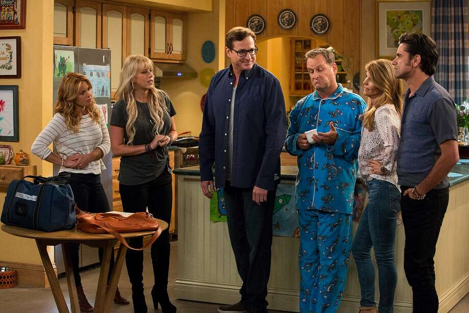 Candace Cameron Bure, Jodie Sweetin, Lori Loughlin, John Stamos, Bob Saget and Dave Coulier in a still from season one of Fuller House on Netflix. Photo: Netflix