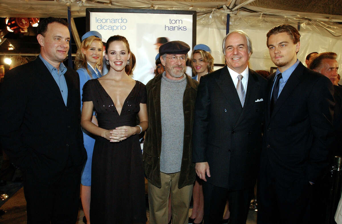 Tom Hanks, Jennifer Garner, Steven Spielberg, Frank Abagnale and Leonardo DiCaprio, from left to right, pose for photographers at a special screening of the film