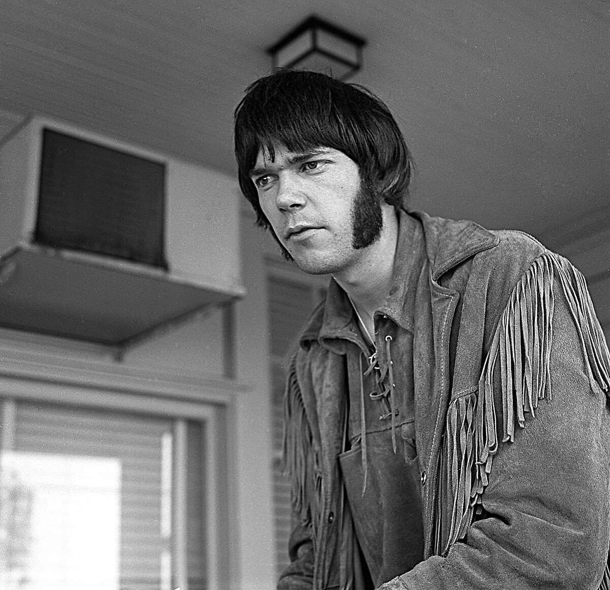 Neil Young, lead guitarist of Buffalo Springfield, as a young man at home in Los Angeles in 1967.