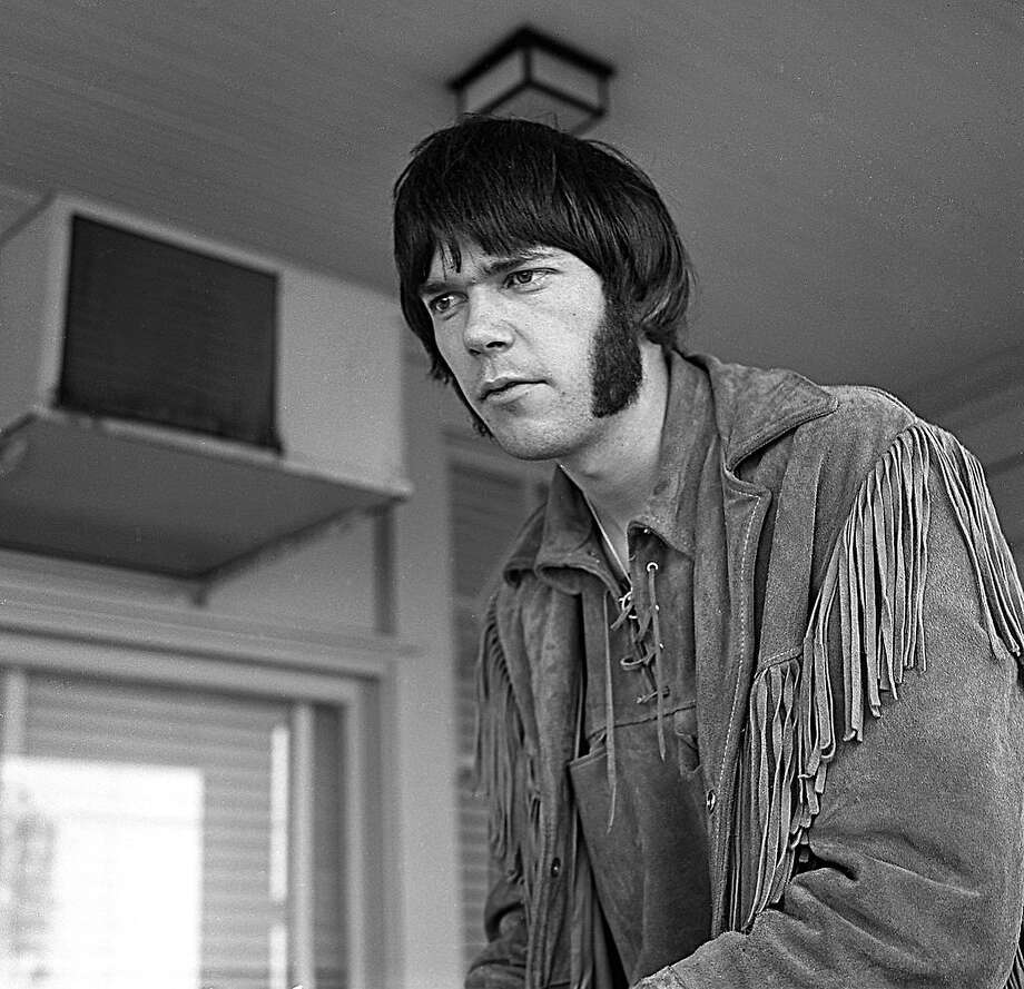 Neil Young, lead guitarist of Buffalo Springfield, as a young man at home in Los Angeles in 1967. Photo: Michael Ochs Archives, Getty Images