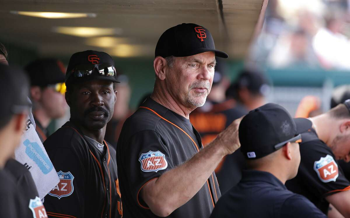 Manager Bruce Bochy watches the action form the dugout as the San Francisco Giants play the Los Angeles Angels at Scottsdale Stadium on Wed. March 2, 2016, in Scottsdale, Arizona.