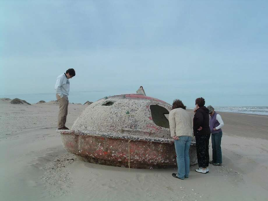 "UFO? No, that's just an old escape pod that washed up on the Padre Island National Seashore. The park posted the photo for its ""Washed up Wednesday"" series.Click through the slideshow to view crazy objects that have washed up on Padre Island National Seashore. Photo: Courtesy,  Padre Island National Seashore"