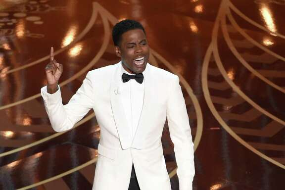 Host Chris Rock speaks at the Oscars at the Dolby Theatre in Los Angeles.  (Photo by Chris Pizzello/Invision/AP, File)