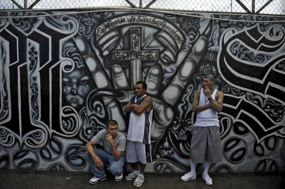 Archive: Mara Salvatrucha gang members attend a mass at the prison of Ciudad Barrios, east of San Salvador, El Salvador.  Photo: JOSE CABEZAS, AFP/Getty Images