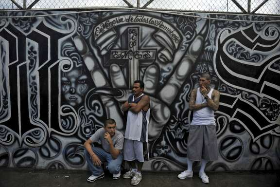 Mara Salvatrucha gang members attend a mass at the prison of Ciudad Barrios, east of San Salvador, El Salvador on June 19, 2012.