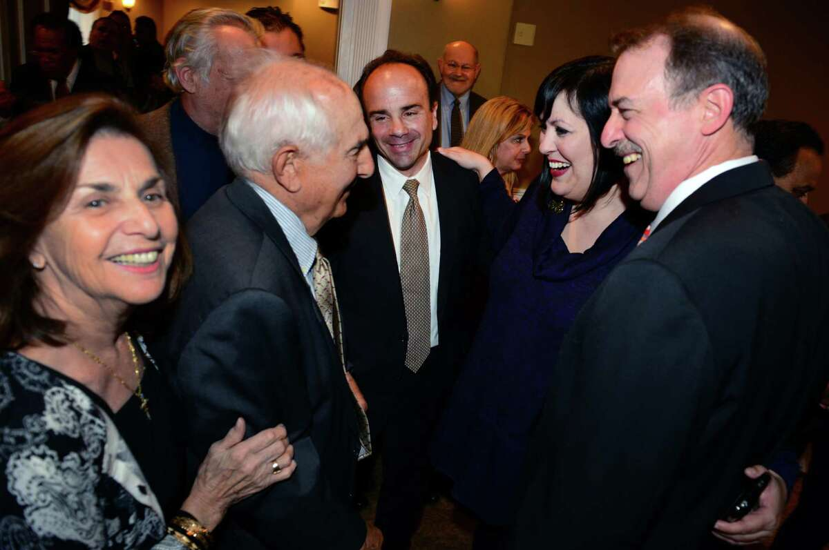 Former Bridgeport Mayor Joseph P. Ganim, center, stands with his parents Josephine, left, and George Sr. during a fundraising event for Ganim at Vazzano's Four Seasons in Stratford, Conn., on Thursday Apr. 23, 2015. At right is Ben Walker with Maria Pereira.