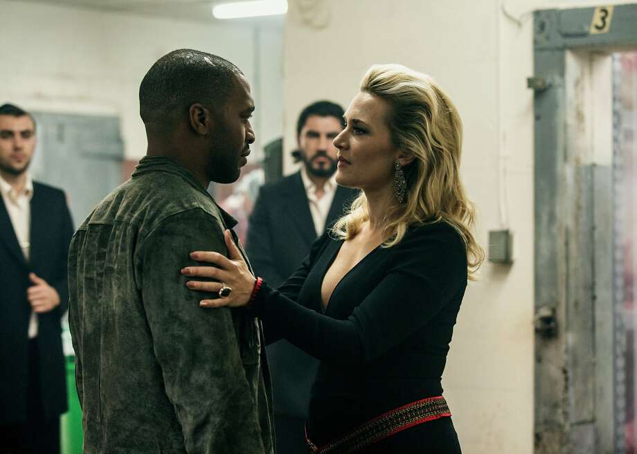 "This image released by Open Road Films shows Chiwetel Ejiofor, left, and Kate Winslet in a scene from ""Triple 9."" (Bob Mahoney/Open Road Films via AP) Photo: Bob Mahoney, Associated Press"