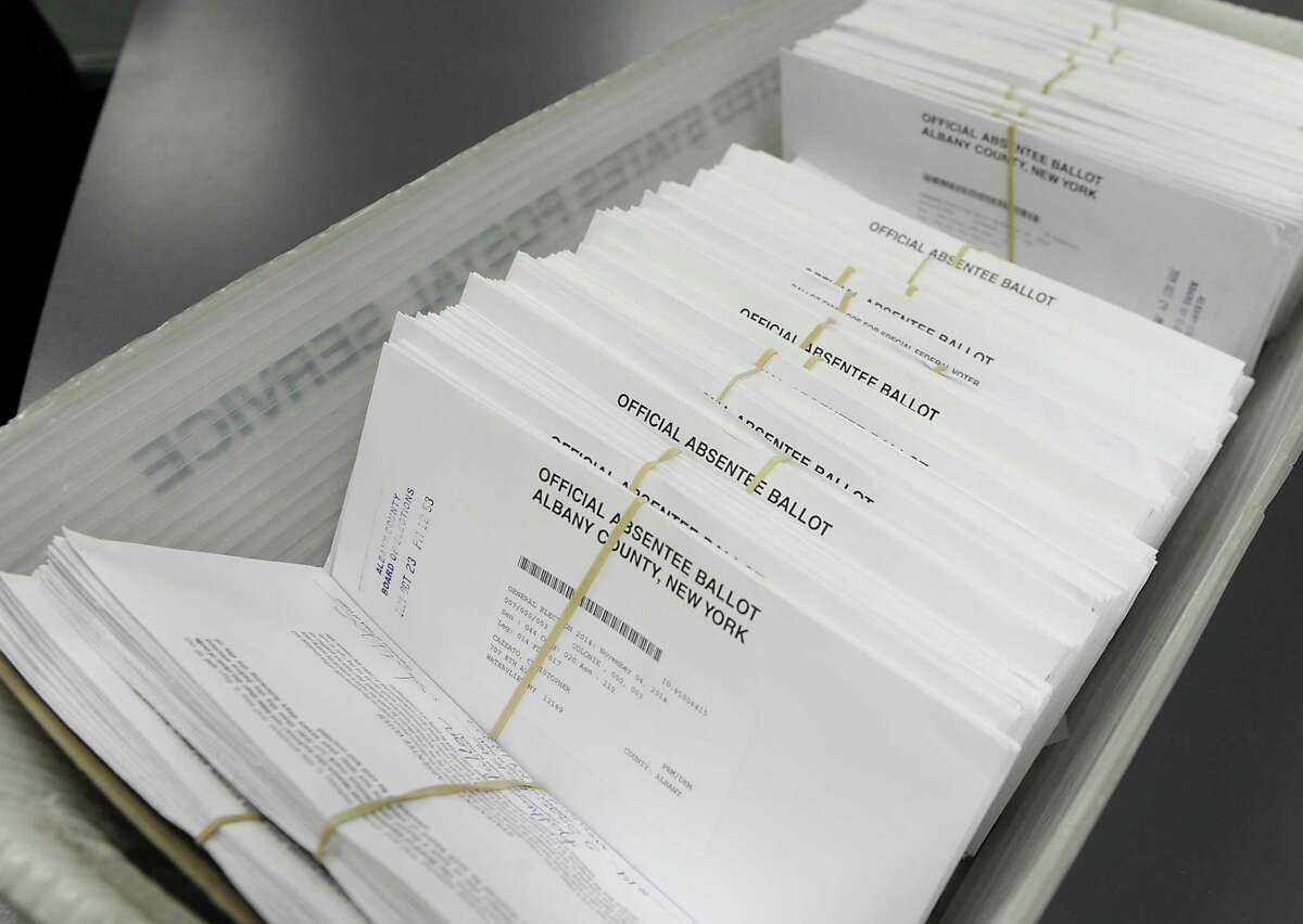A bin of absentee ballots for the general election is seen at the Albany County Board of Elections on Monday, Nov. 3, 2014, in Albany, N.Y. (Lori Van Buren / Times Union archive)
