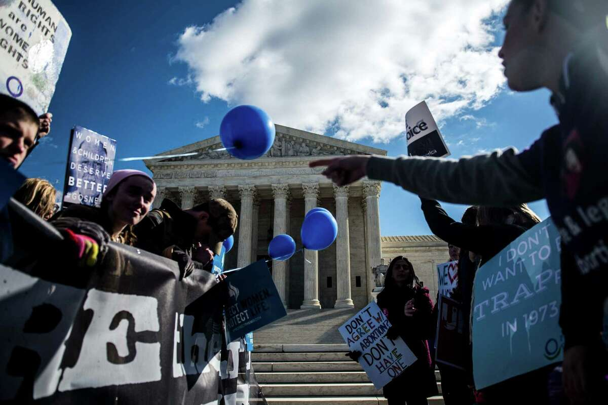 Anti-abortion and pro-abortion rights demonstrators rally outside the U.S. Supreme Court.