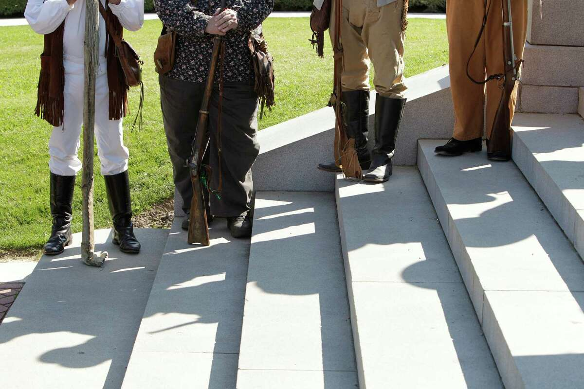 Texas historical reenators listen during a ceremony honoring Texas Independence Day Wednesday, March 2, 2016, in Houston. The Texas Army, The Sons of the Republic of Texas, The Daughters of the Republic of Texas along with others honored Texas Independence Day at the Sam Houston Statue.