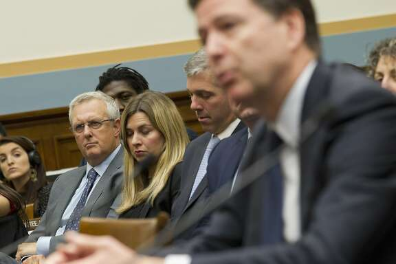Apple Senior Vice President and General Counsel Bruce Sewell, listens at left as FBI Director James Comey testifies on Capitol Hill in Washington, Tuesday, March 1, 2016, before the House Judiciary Committee hearing on 'The Encryption Tightrope: Balancing Americans' Security and Privacy.' ( AP Photo/Jose Luis Magana)