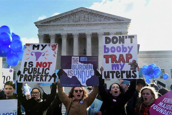 Pro-abortion rights protesters rally outside the Supreme Court in Washington, Wednesday, March 2, 2016. The abortion debate is returning to the Supreme Court in the midst of a raucous presidential campaign and less than three weeks after Justice Antonin Scalia's death. The justices are taking up the biggest case on the topic in nearly a quarter century and considering whether a Texas law that regulates abortion clinics hampers a woman's constitutional right to obtain an abortion. (AP Photo/Susan Walsh)